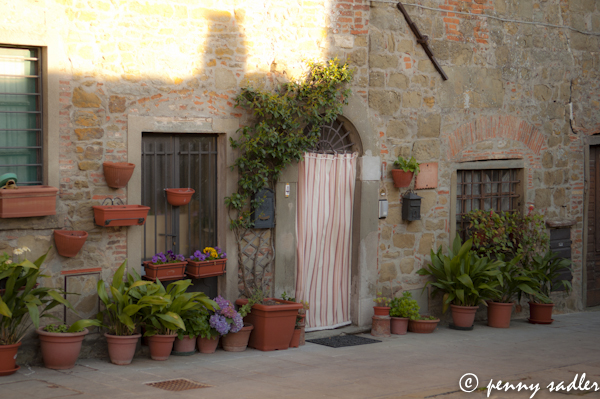 Beautiful doorway with flower pots in small town i Chianti